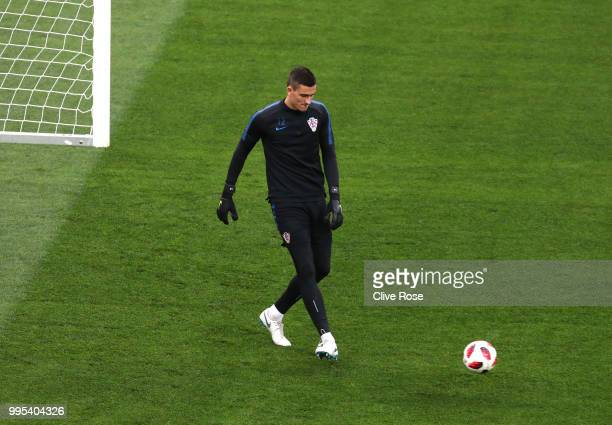 Lovre Kalinic of Croatia passes the ball during the Croatia Training Session at the Luzhniki Stadium on July 10 2018 in Moscow Russia