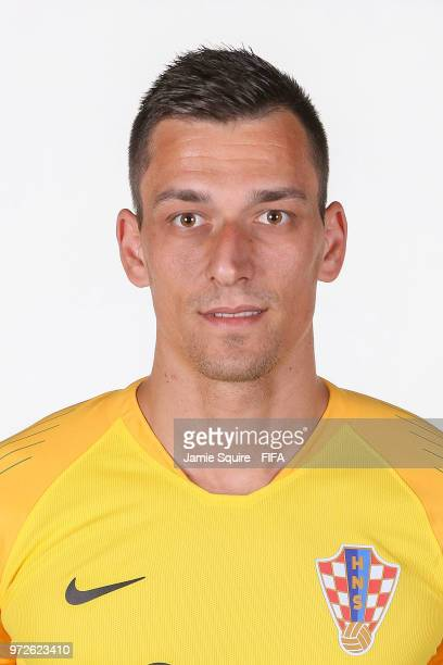 Lovre Kalinic of Croatia poses for a portrait during the official FIFA World Cup 2018 portrait session at Woodland Rhapsody Resort on June 12 2018 in...
