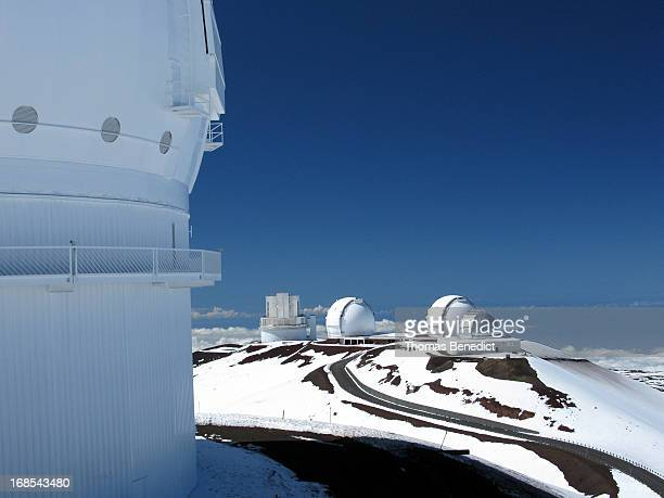 Low altitude aerial view of the catwalk on the dome of the Canada-France-Hawaii Telescope with Subaru, Keck 1, Keck 2, and the NASA Infrared...