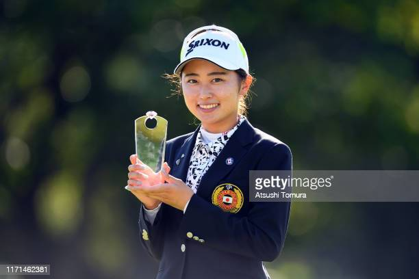 Low amateur Yuka Yasuda of Japan poses with the trophy at the award ceremony following the final round of the Nitori Ladies at Otaru Country Club on...