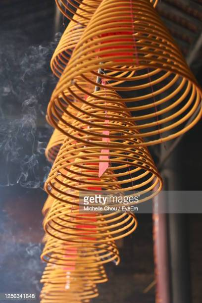 low angel view of incense coil hanging in temple - incense coils stock pictures, royalty-free photos & images