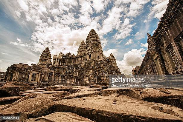 Low Angel View Of Old Temples Against Cloudy Sky