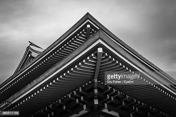 low angel view of pagoda against cloudy sky - pagoda stock pictures, royalty-free photos & images