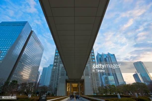 low angle afternoon view of city hall in tokyo, japan - nishi shinjuku stock-fotos und bilder
