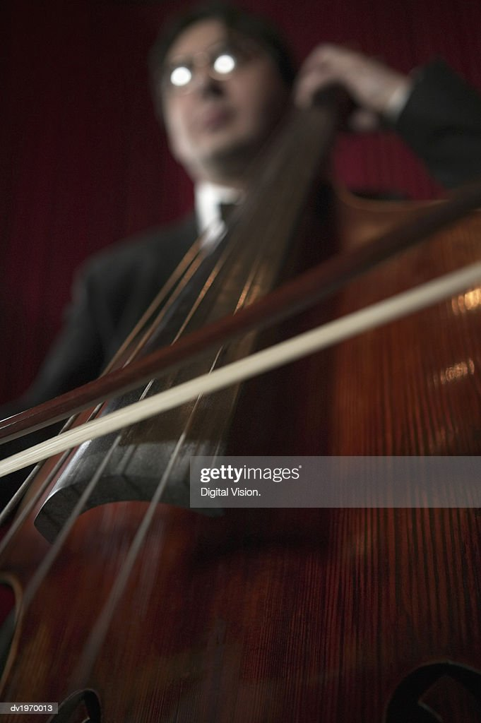 Low Angle Close-Up of a Cellist : Stock Photo
