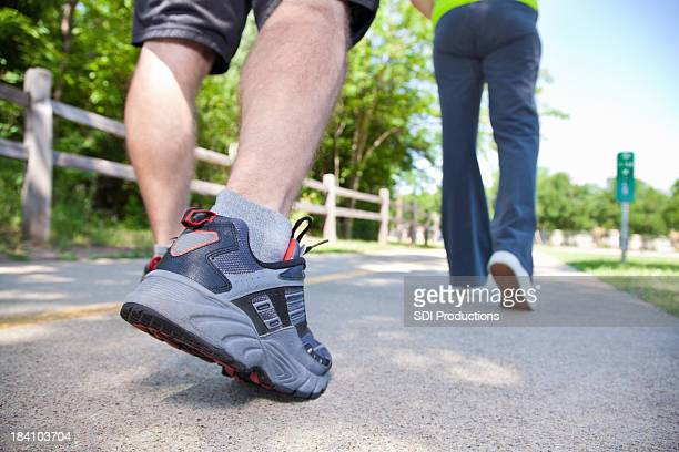 Low Angle Closeup View of Exercisers Walking