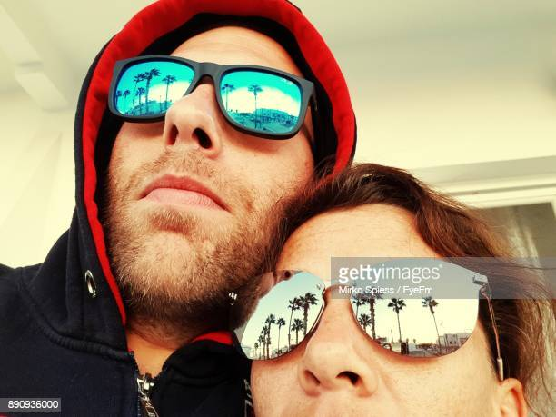 Low Angle Close-Up Young Couple Wearing Sunglasses