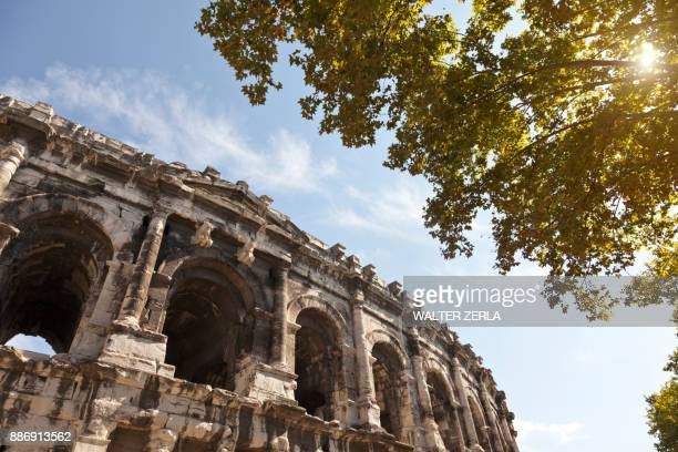low angle detail of arena of nimes, nimes, languedoc-roussillon, france - nimes stock pictures, royalty-free photos & images