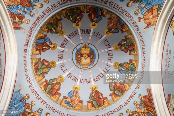 Low angle interior view of the decorated dome of the historic Kashveti Church of St George in Tbilisi