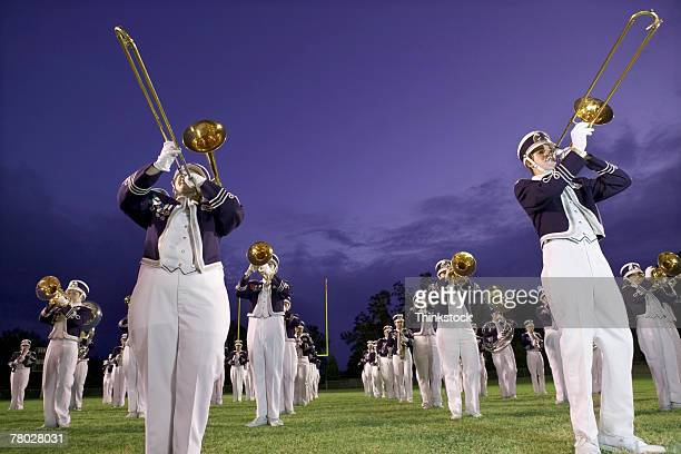 Low angle of a marching band performing on the football field.