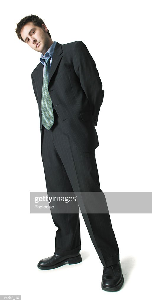 low angle of a young caucasian man in a business suit as he glares forward with attitude : Foto de stock