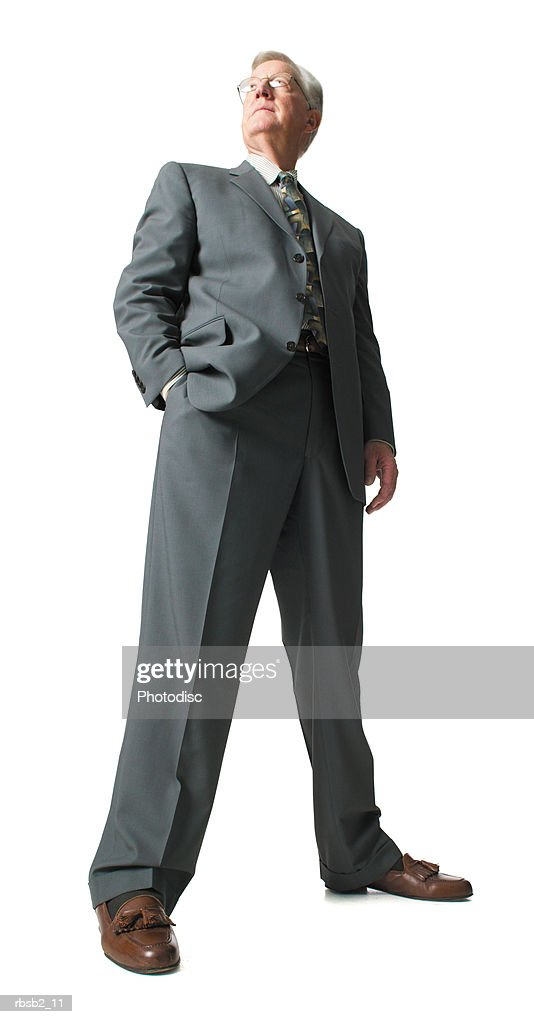 low angle of an elderly caucasian business man as he confidently looks off in the distance : Stockfoto