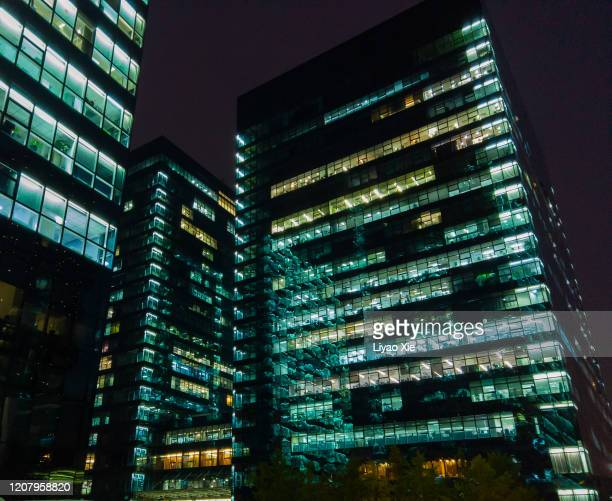 low angle of office building - 996 working hour system stock pictures, royalty-free photos & images