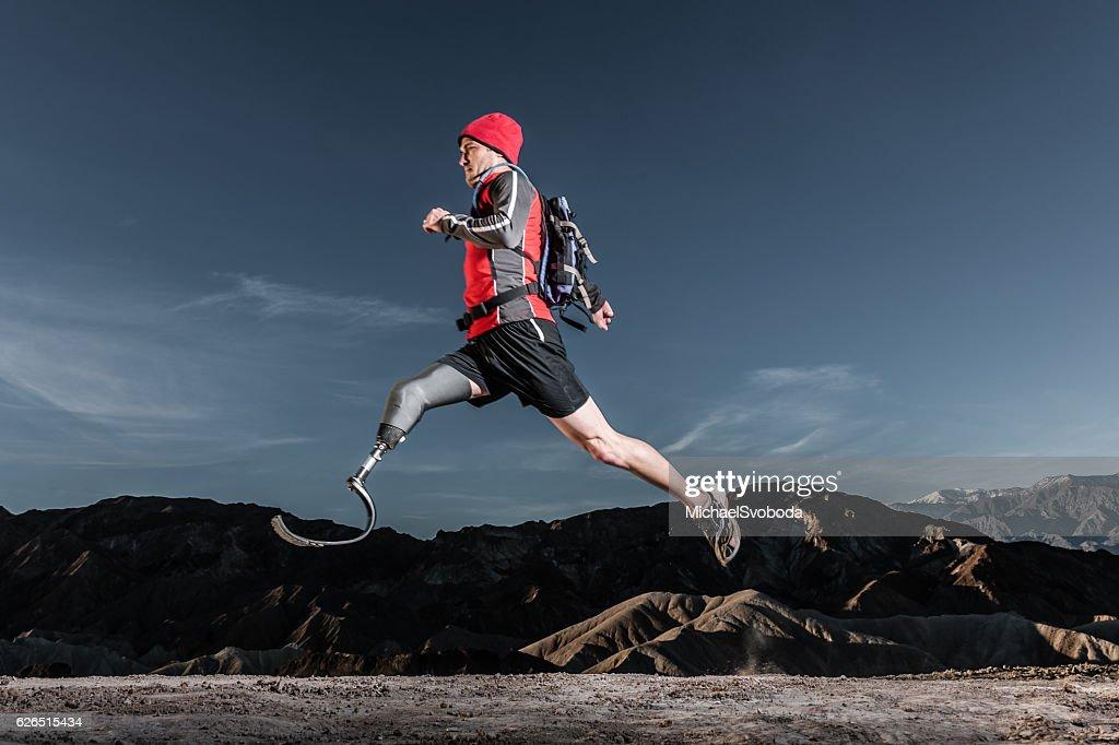 Low Angle Of Prosthetic Leg Running AT Sunrise : Stock Photo
