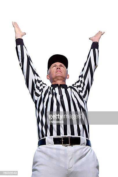 low angle of referee signaling a touchdown. - american football referee stock pictures, royalty-free photos & images