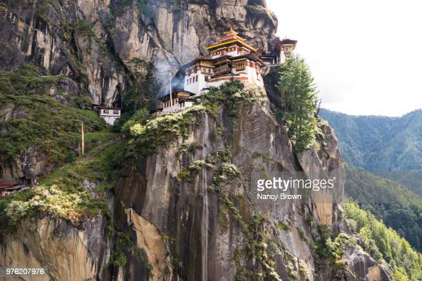 low angle of the tigers nest in bhutan in asia. - paro stock pictures, royalty-free photos & images