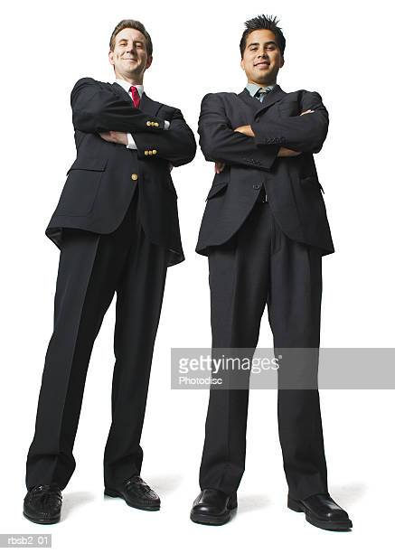 low angle of two business men in suits as they fold their arms and smile - low angle view stock pictures, royalty-free photos & images