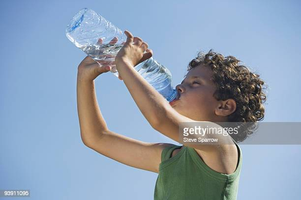 Low angle of young boy drinking water