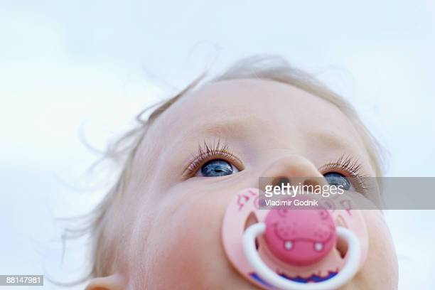 low angle portrait of baby with pacifier