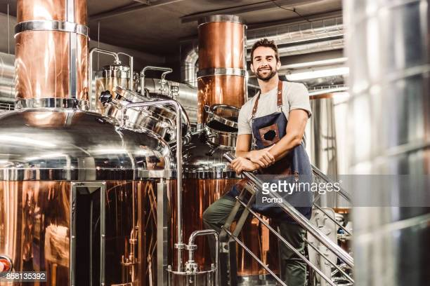 Low angle portrait of male manager at brewery