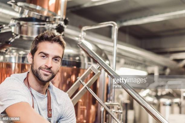 Low angle portrait of male owner at microbrewery
