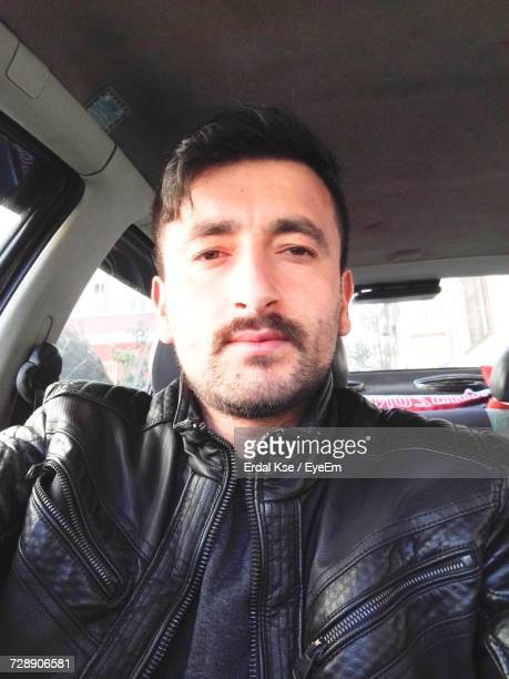 low angle portrait of man sitting in car - trabzon stock pictures, royalty-free photos & images