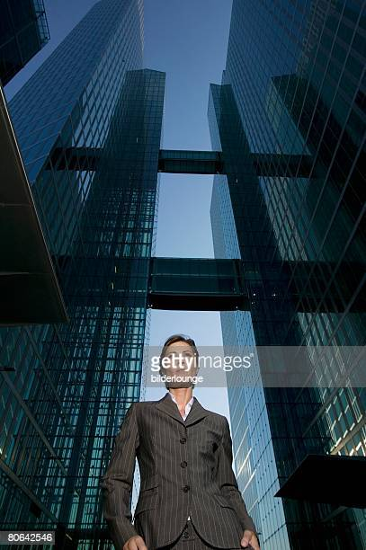 low angle portrait of mature businesswoman in front of office building