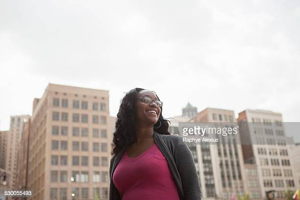 Low angle portrait of smiling woman, Detroit, Michigan, USA