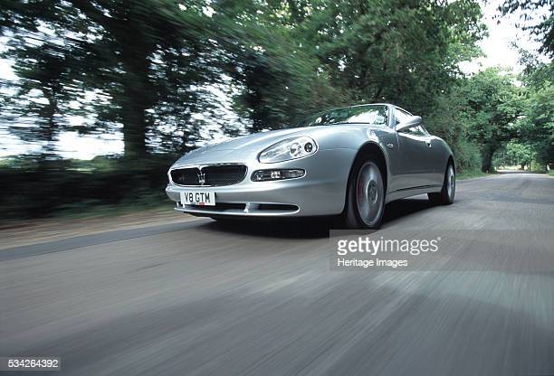 Low angle shot of Maserati 3200 Gt driving at speed 2000