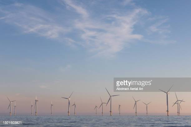 low angle shot showing an offshore wind farm, redcar, england, united kingdom - sea stock pictures, royalty-free photos & images