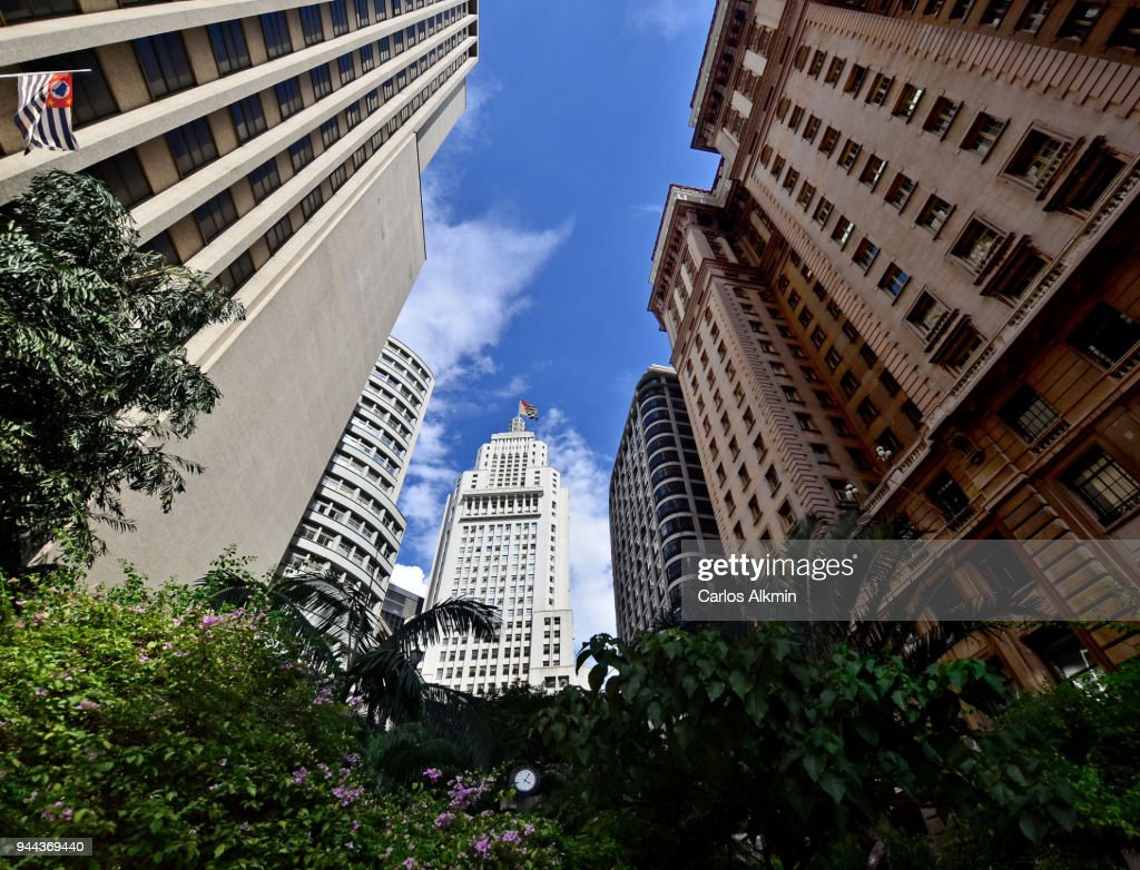 Low angle shot with a classic view of Sao Paulo downtown iconic skyscrapers with Sao Paulo State flags : Stock Photo