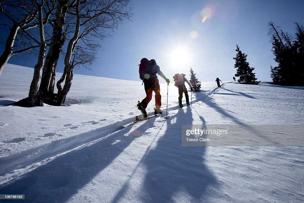 cbd7a8d64 Low Angle Silhouette Of Four Men Backcountry Ski Touring Stock Photo ...