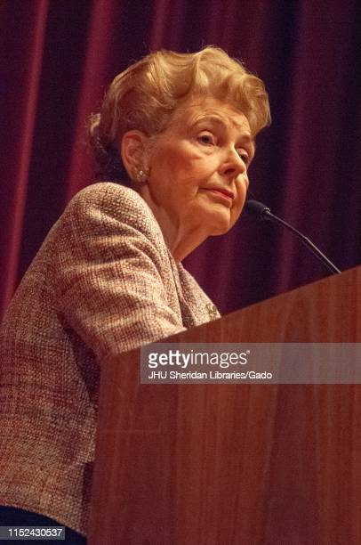Low angle three quarter profile shot of Phyllis Schlafly standing behind a podium while speaking during a Milton S Eisenhower Symposium Homewood...