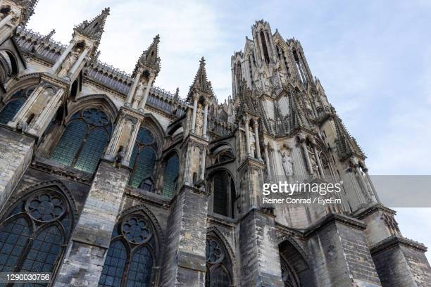 low angle view at a part of cathedral notre dame in reims, france - マルヌ県 ストックフォトと画像