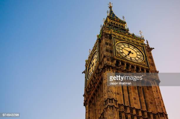 low angle view at big ben, london, england - 時計台 ストックフォトと画像