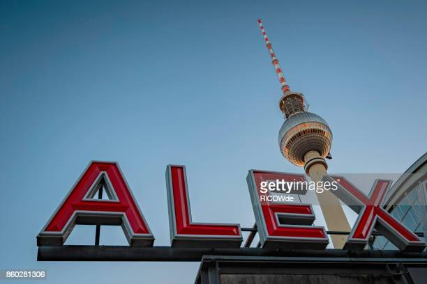 Low angle view at tv tower and alex sign, Berlin, Germany.
