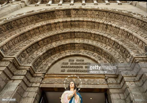 low angle view in front of a church with statue of virgin mary - old manila stock pictures, royalty-free photos & images