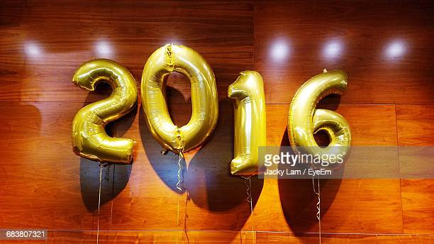 Low Angle View Of 2016 Balloons Hanging On Wooden Wall At Graduation Ceremony