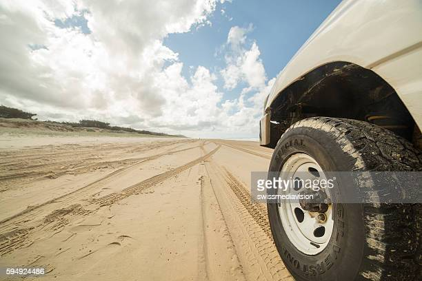 Low angle view of 4x4 on sand, Fraser Island