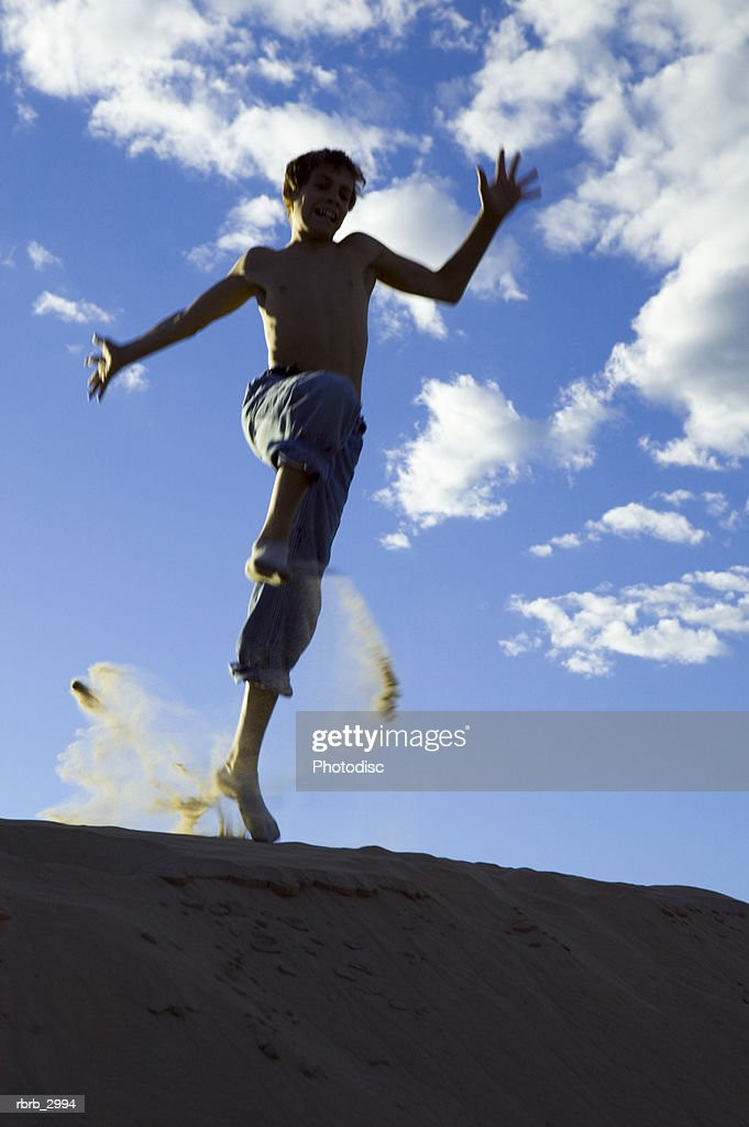 Low angle view of a boy jumping : Foto de stock