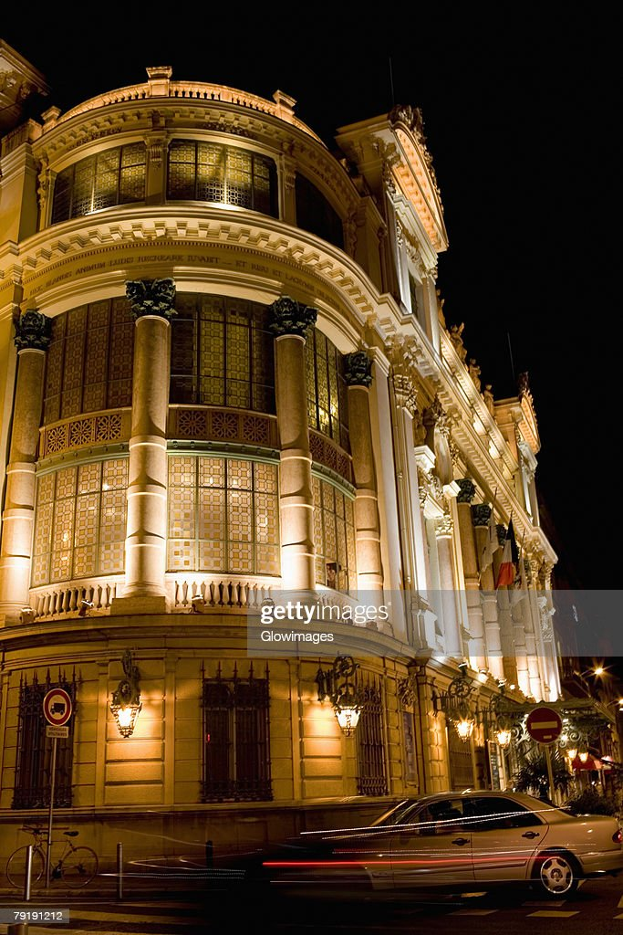 Low angle view of a building lit up at night, Nice, France : Stock Photo