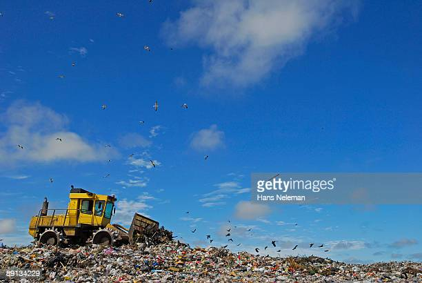 Low angle view of a bulldozer removing garbage dump, Montevideo, Uruguay