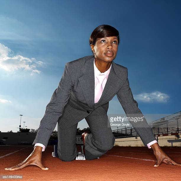 low angle view of a businesswoman ready to run a race