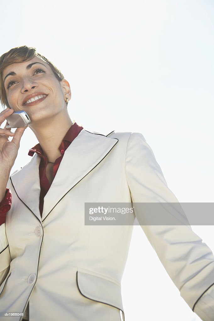 Low Angle View of a Businesswoman Using Her Mobile Phone : Stock Photo