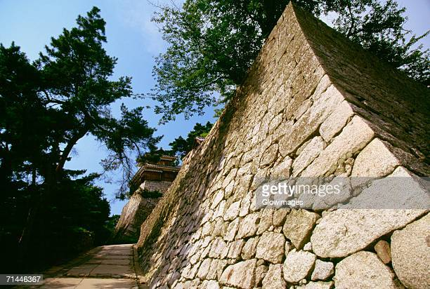 low angle view of a castle, matsuyama castle, shikoku, japan - matsuyama ehime stock pictures, royalty-free photos & images