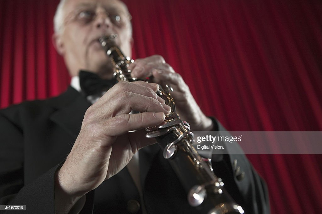 Low Angle View of a Clarinet Player : Stock Photo