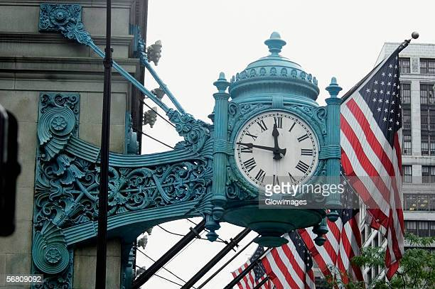 Low angle view of a clock on a building, Marshall Field's Building, Chicago, Illinois, USA