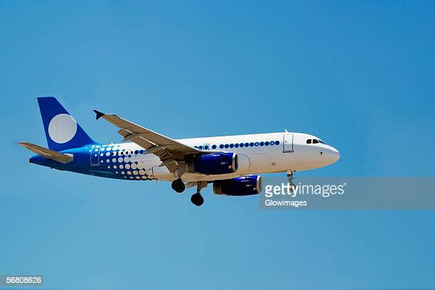 Low angle view of a commercial airplane in flight, San Diego, California, USA