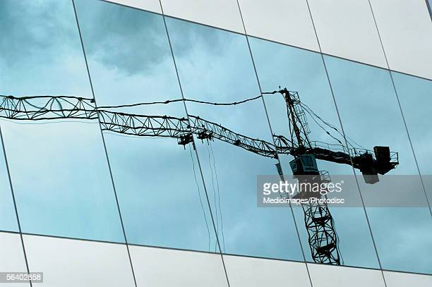 Low angle view of a crane reflected on the window