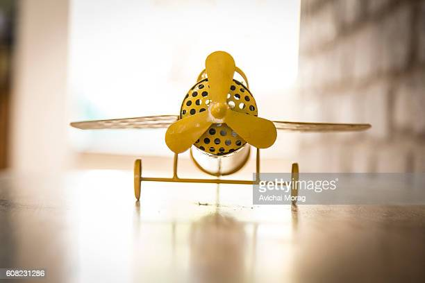 low angle view of a decorative toy plane - doppeldecker flugzeug stock-fotos und bilder